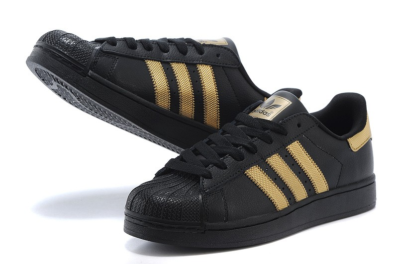 black and gold adidas superstar